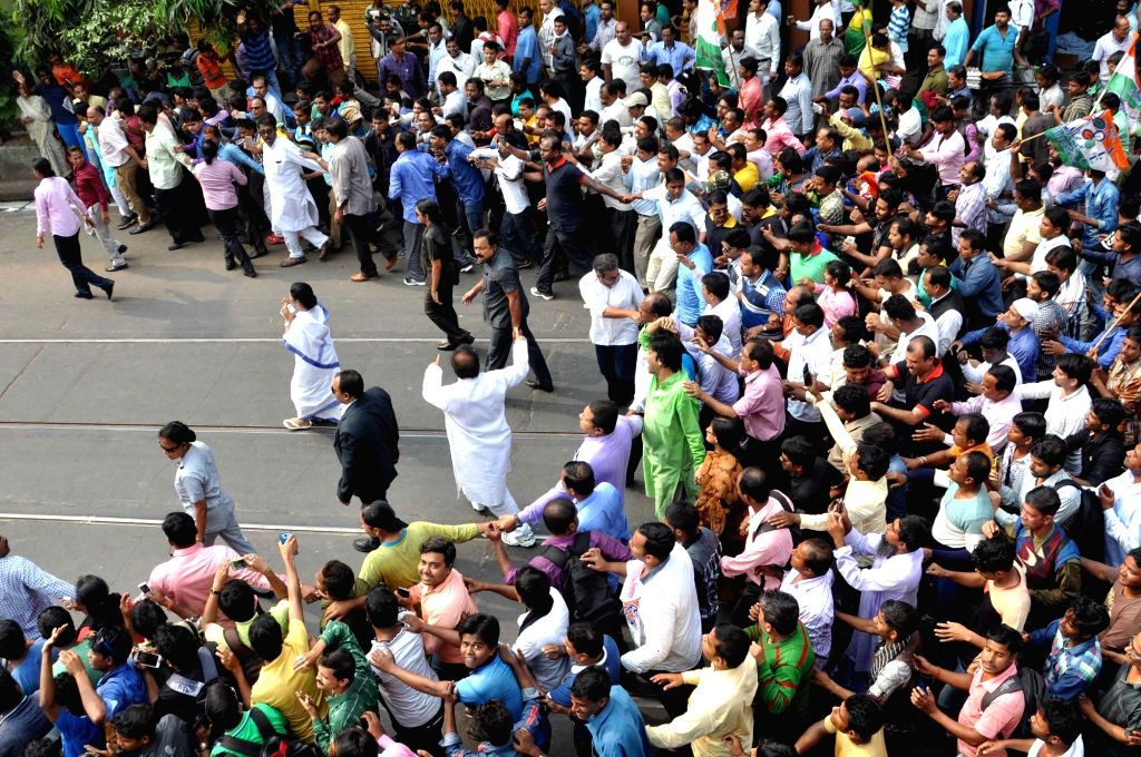 West Bengal Chief Minister and TMC supremo Mamata Banerjee with other leaders participate in a march against demonetisation in Kolkata on Nov 28, 2016. - Mamata Banerjee
