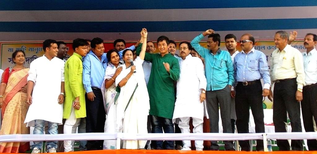 West Bengal Chief Minister and Trinamool Congress supremo Mamata Banerjee with party's candidate for 2014 Lok Sabha Election from Darjeeling Lok Sabha seat, Bhaichung Bhutia during a rally in Chopra .