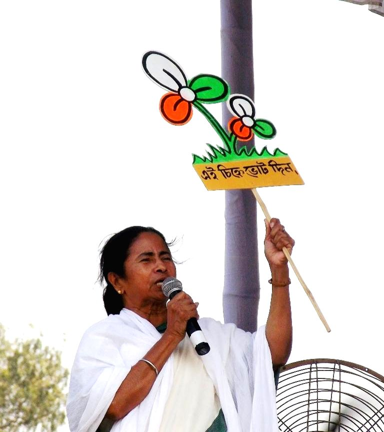 West Bengal Chief Minister and Trinamool Congress supremo Mamata Banerjee holds a her party's symbol as she addresses a rally in Chopra of West Bengal's North Dinajpur district on April 11, 2014.