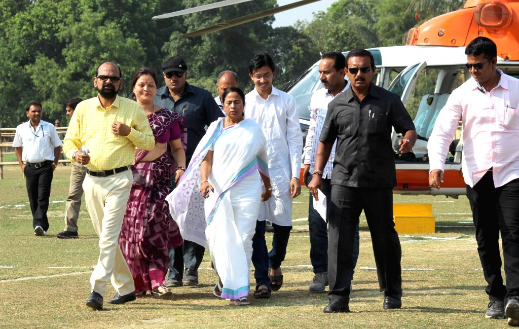 West Bengal Chief Minister and Trinamool Congress supremo Mamata Banerjee arrives to attend a rally in Malda on April 15, 2014.