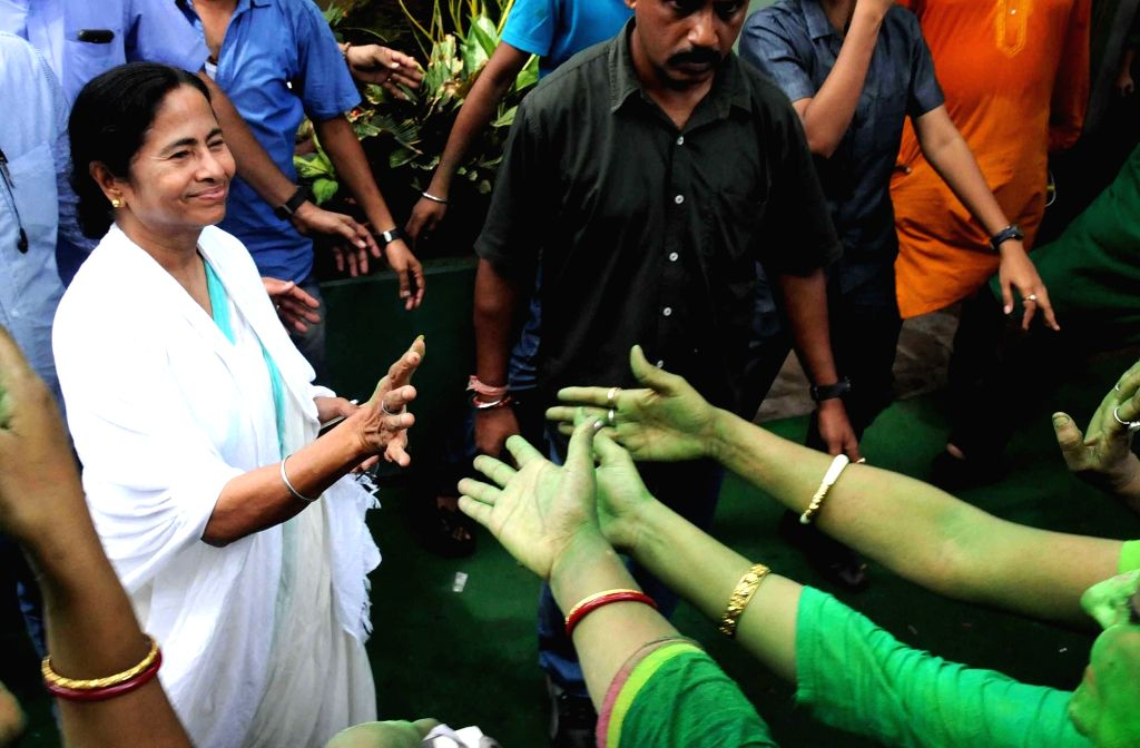 West Bengal Chief Minister and Trinamool Congress supremo Mamata Banerjee interacts with party workers after a press conference regarding party's performance in the recently concluded 2016 ... - Mamata Banerjee