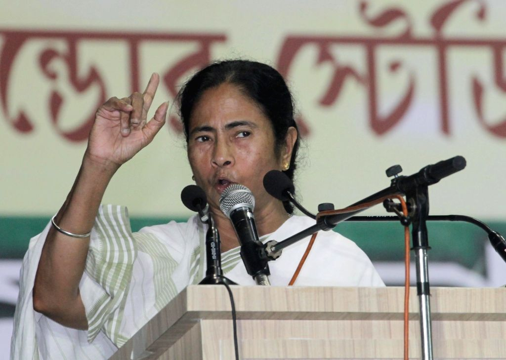 West Bengal Chief Minister and Trinamool Congress supremo Mamata Banerjee addresses during a party programme in Kolkata on June 18, 2016. - Mamata Banerjee