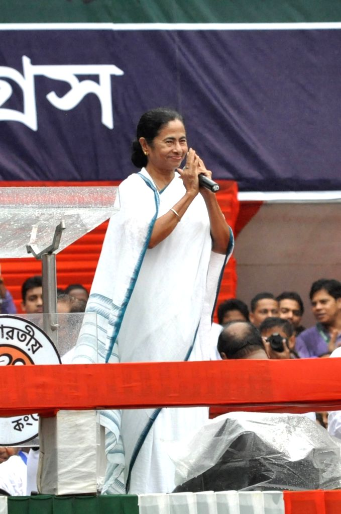 West Bengal Chief Minister and Trinamool Congress (TMC) chief Mamata Banerjee addresses during her party's 25th Martyr's Day rally, in Kolkata on July 21, 2018. - Mamata Banerjee