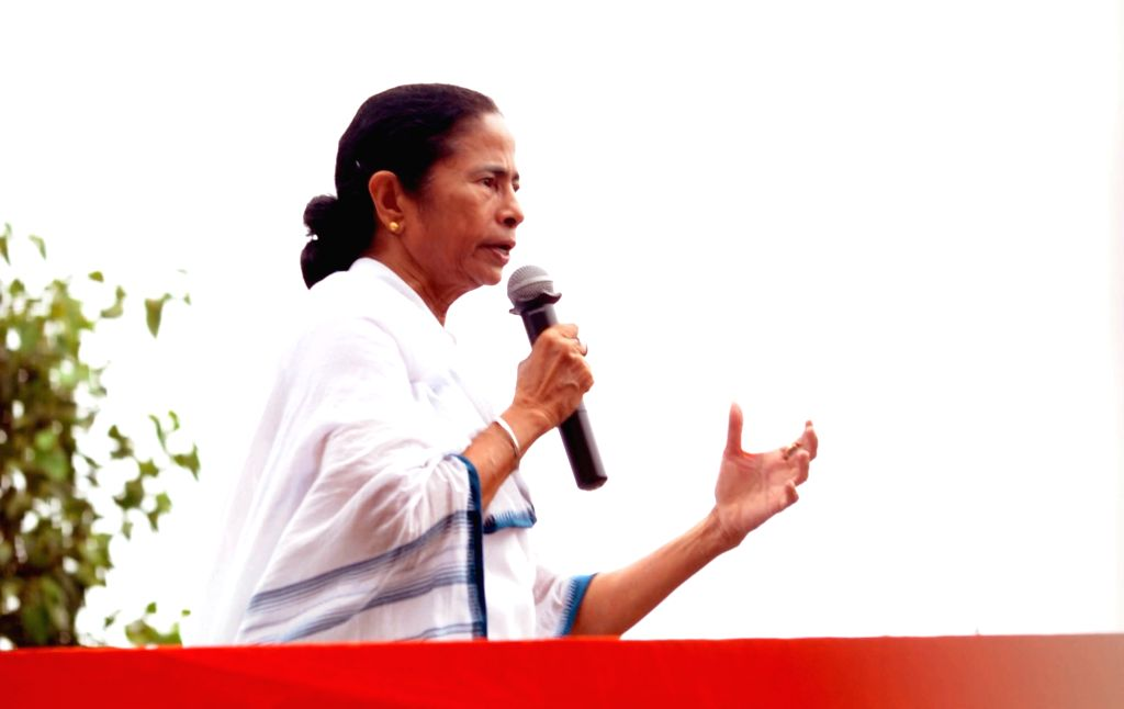 West Bengal Chief Minister and Trinamool Congress (TMC) supremo Mamata Banerjee addresses at party's Martyrs' Day rally, in Kolkata on July 21, 2018. - Mamata Banerjee