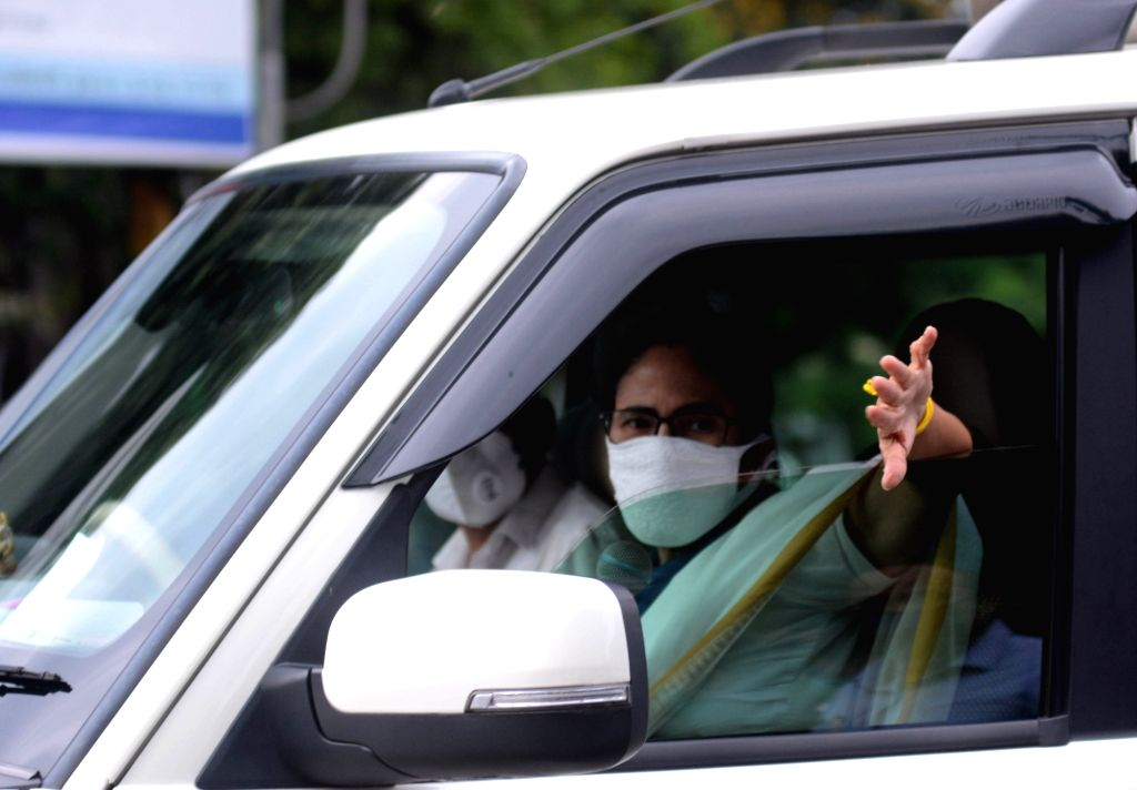 West Bengal Chief Minister Mamata Banerjee interacts with people from her cavalcade during her inspection round across Kolkata amid the extended nationwide lockdown imposed to mitigate the ... - Mamata Banerjee