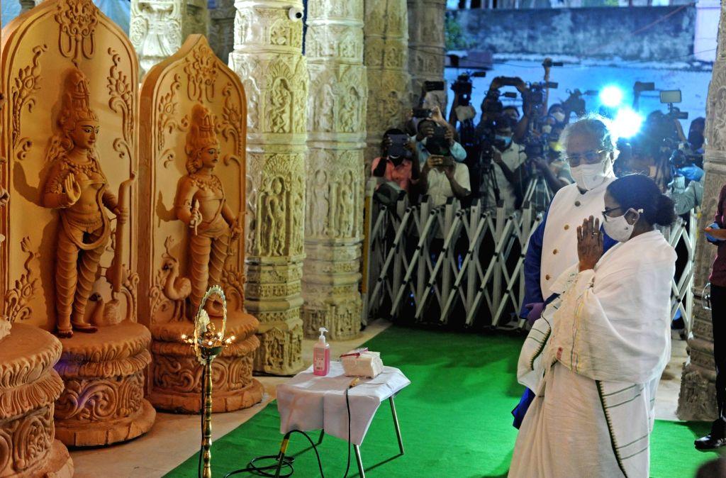 West Bengal Chief Minister Mamata Banerjee inaugurated Ahiritola Durgotsav on the eve of Durga Puja celebrations, in Kolkata on Oct 14, 2020. - Mamata Banerjee