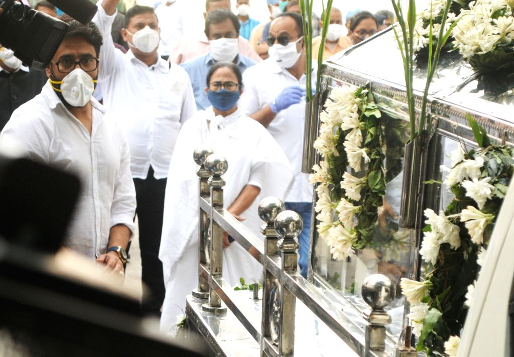 West Bengal Chief Minister Mamata Banerjee arrived at Belle Vue Nursing Home to pay last homage to eminent actor Soumitra Chatterjee who died in Kolkata on November 15, 2020. - Mamata Banerjee and Soumitra Chatterjee