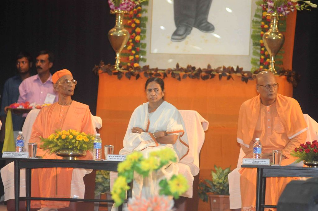 West Bengal Chief Minister Mamata Banerjee flanked by Secretary of R.K Mission Institute of Culture, Swami Suparnananda (right) and General secretary  of Ramakrishna Math and Mission Swami ... - Mamata Banerjee