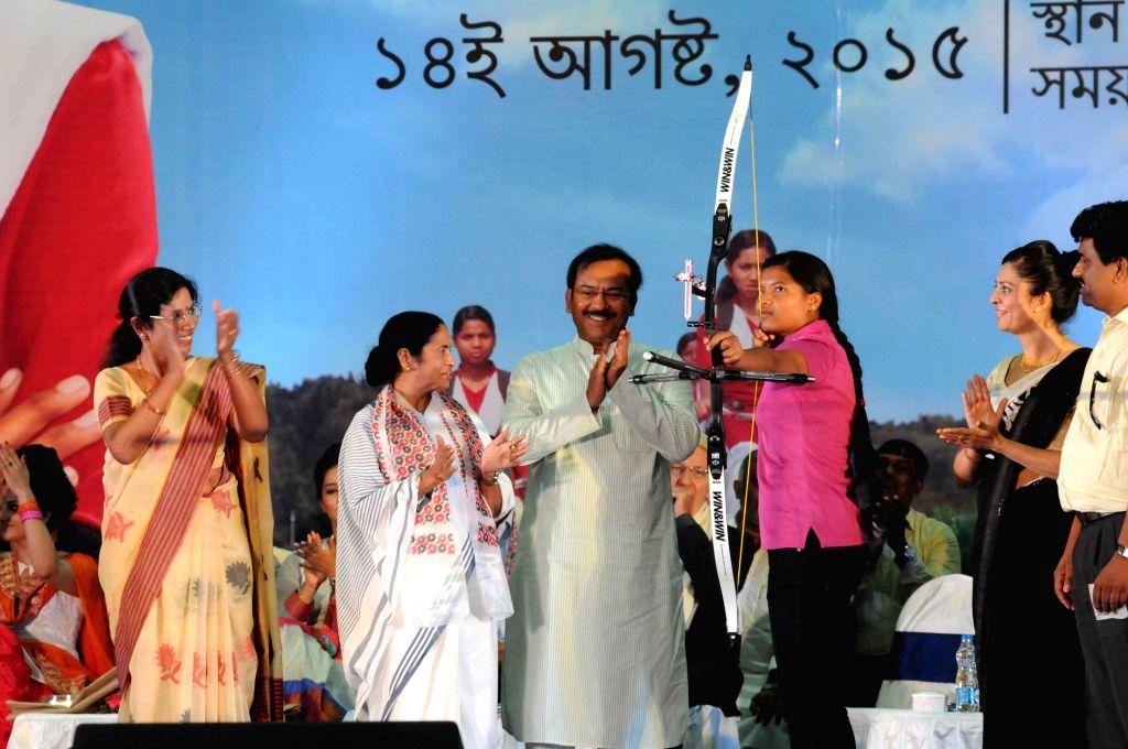 West Bengal Chief Minister Mamata Banerjee, minister Aroop Biswas and others during 'Kannyashree'  programme in Kolkata, on Aug 14, 2015. - Mamata Banerjee