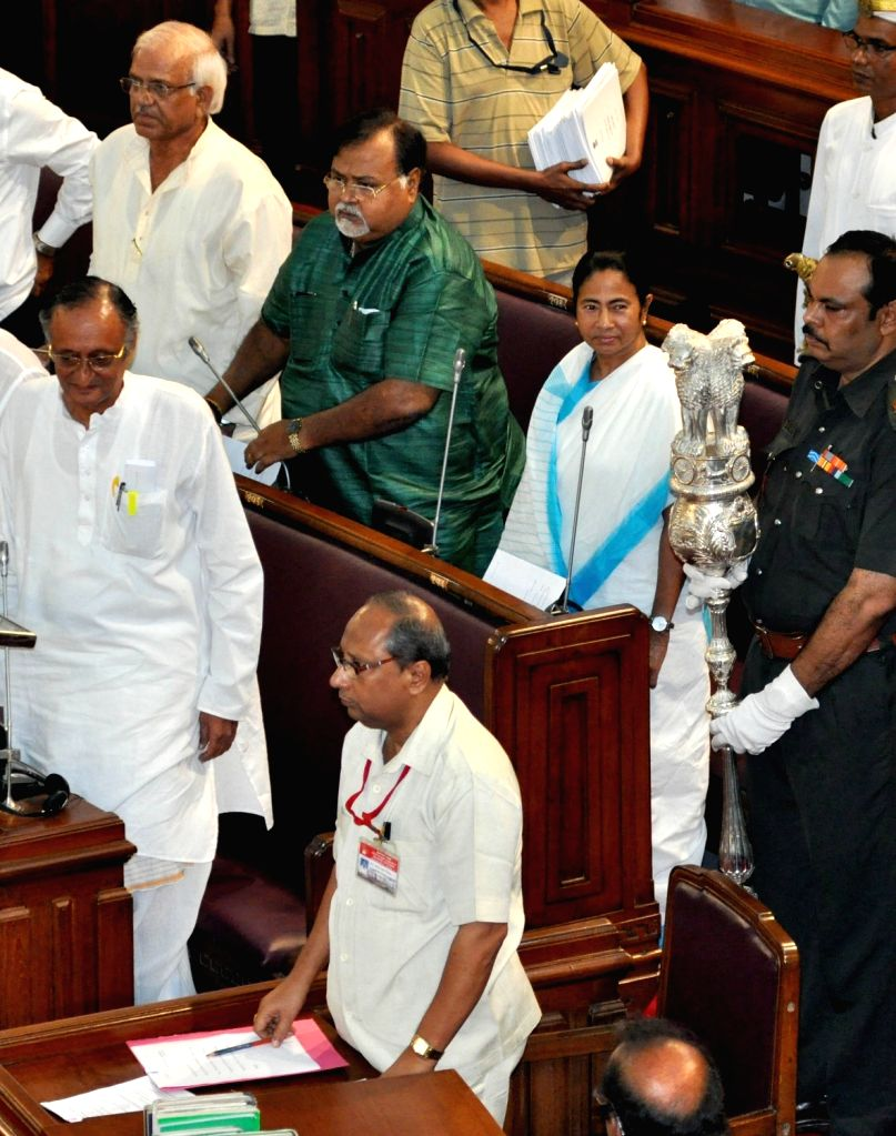 West Bengal Chief Minister Mamata Banerjee, Finance Minister Amit Mitra and Education Minister Partha Chatterjee at the state assembly during budget session in Kolkata on June 24, 2016. - Mamata Banerjee and Partha Chatterjee