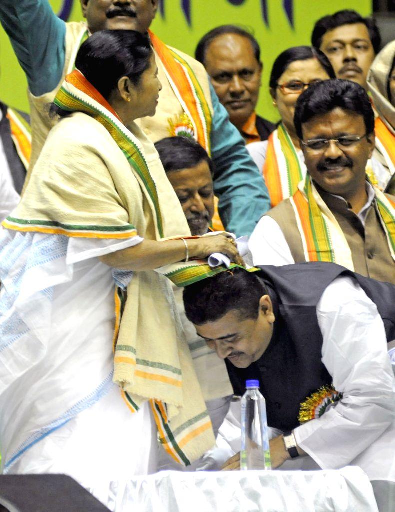 West Bengal Chief Minister Mamata Banerjee blesses MP Subhendu Adhikery during workshop of Trinamul Congress in Kolkata on Feb. 4. - Mamata Banerjee