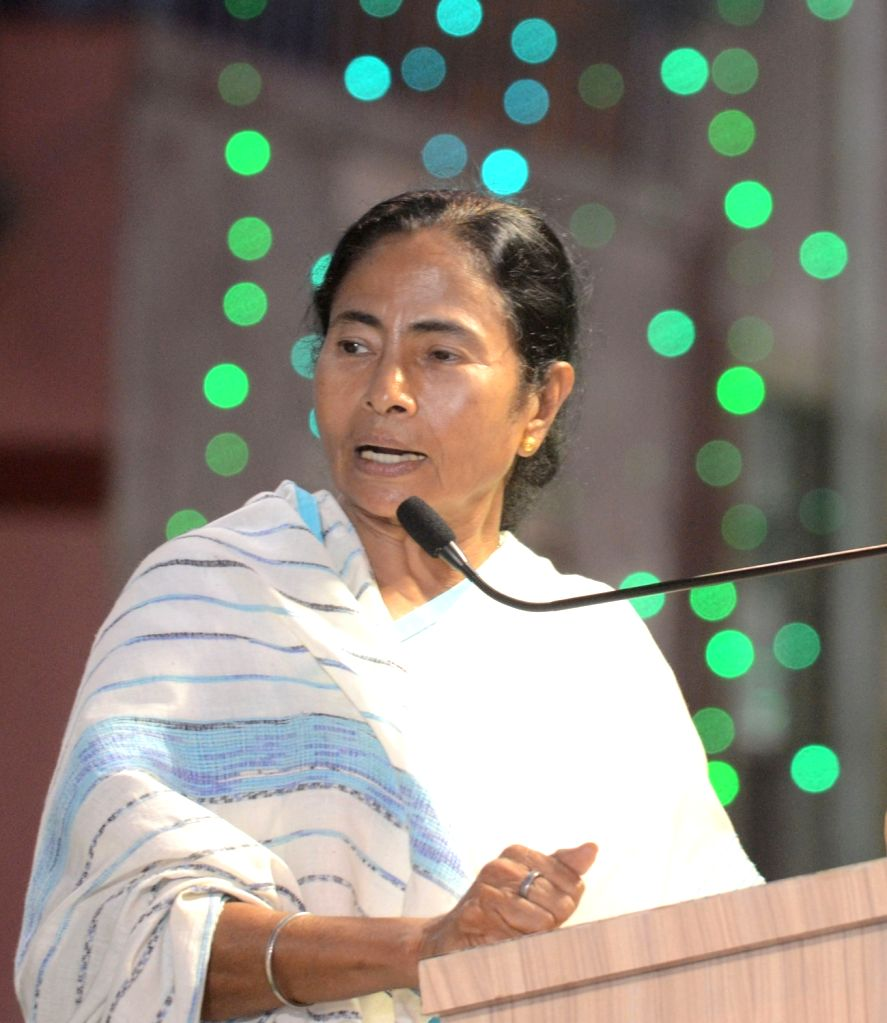 West Bengal Chief Minister Mamata Banerjee addresses during the inauguration of the Sree Bhumi Sporting Club Durga Puja festival in Kolkata on Sept 28, 2016. - Mamata Banerjee