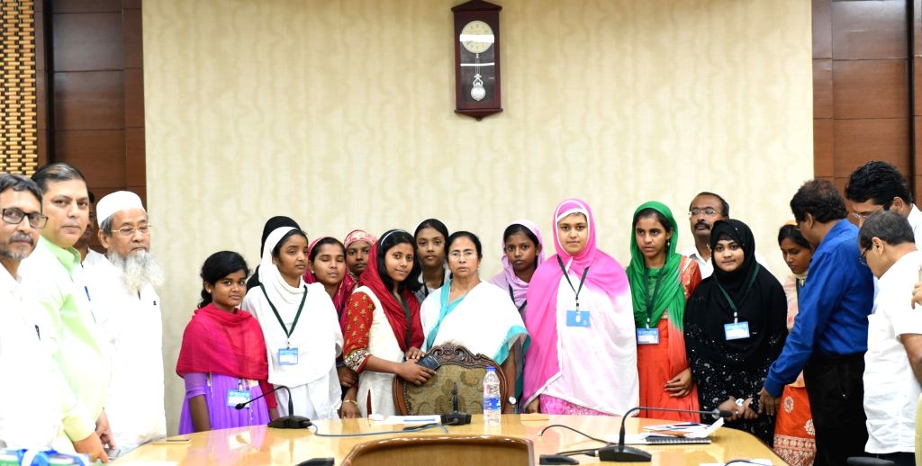 "West Bengal Chief Minister Mamata Banerjee felicitates Madrasa toppers at Nabanna in Howrah on June 14, 2017. (Photo"" IANS) - Mamata Banerjee"