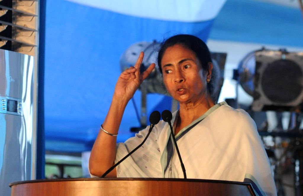West Bengal Chief Minister Mamata Banerjee addresses during a programme to pay tribute to the memories of esteemed and noted journalists in Kolkata on June 17, 2017. - Mamata Banerjee