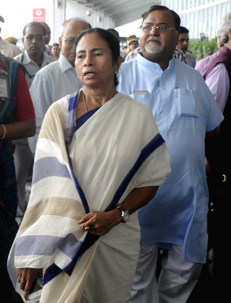 West Bengal Chief Minister Mamata Banerjee arrives at Netaji Subhas Chandra Bose International Airport to leave for Netherlands; in Kolkata on June 19, 2017. Mamata will address the Public ... - Mamata Banerjee