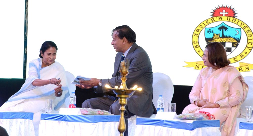 West Bengal Chief Minister Mamata Banerjee interacts with ArcelorMittal Chairman and CEO Lakshmi N Mittal during a programme organised to start the first academic session of St. Xavier's ... - Mamata Banerjee