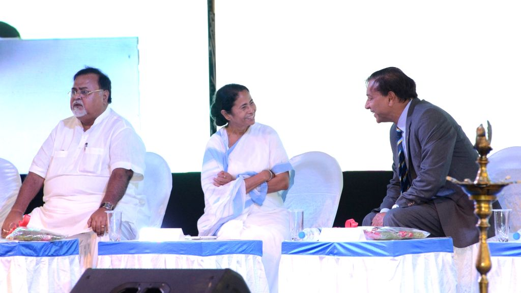 West Bengal Chief Minister Mamata Banerjee interacts with ArcelorMittal Chairman and CEO Lakshmi N Mittal during a programme organised to start the first academic session of St. Xavier's ... - Mamata Banerjee and Partha Chatterjee