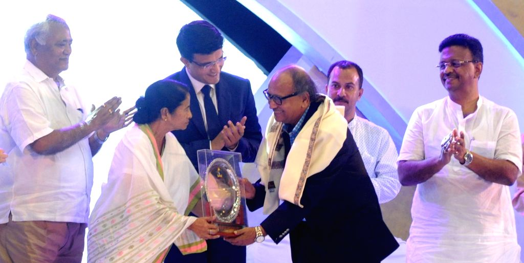 West Bengal Chief minister Mamata Banerjee presents the life time achievement award to Cricket coach Pranab Nandi during CAB Annual Awards Ceremony 2016-17 in Kolkata on Aug 8, 2017. Also ... - Mamata Banerjee and Sourav Ganguly
