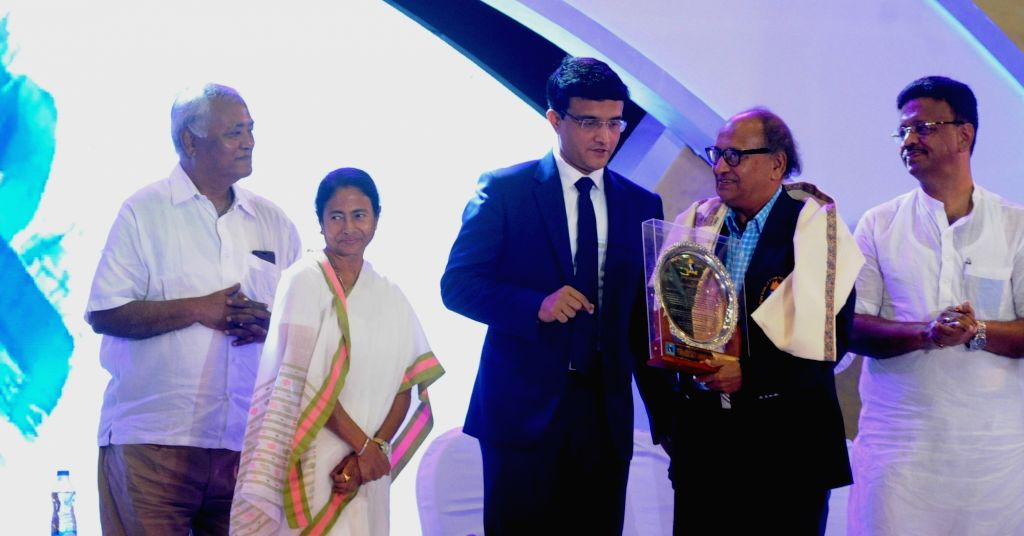 West Bengal Chief minister Mamata Banerjee, Cricket Association of Bengal (CAB) President Sourav Ganguly and Cricket coach Pranab Nandi during CAB Annual Awards Ceremony 2016-17 in Kolkata ... - Mamata Banerjee and Sourav Ganguly