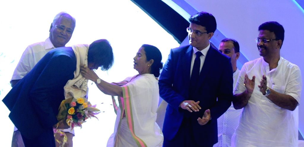 West Bengal Chief minister Mamata Banerjee felicitates Indian woman cricketer Jhulan Goswami during CAB Annual Awards Ceremony 2016-17 in Kolkata on Aug 8, 2017. Also seen Cricket ... - Mamata Banerjee, Sourav Ganguly and Jhulan Goswami