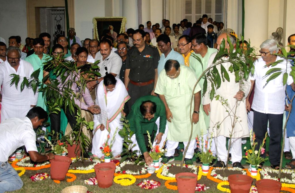 West Bengal Chief Minister Mamata Banerjee, Speaker Biman Banerjee and others during Van Mahotsav at the state assembly in Kolkata, on Aug 8, 2017. - Mamata Banerjee and Biman Banerjee