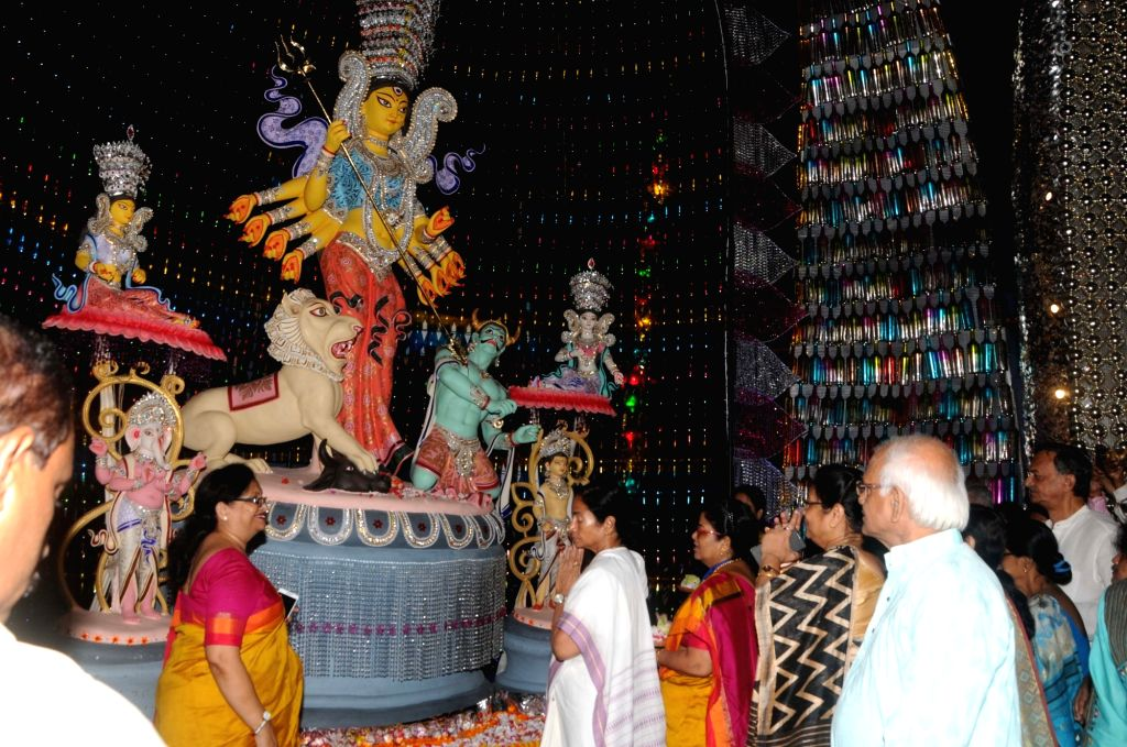 West Bengal Chief Minister Mamata Banerjee inaugurates Hindustan Club's Pandal ahead of Durga Puja in Kolkata on Sept 19, 2017. - Mamata Banerjee