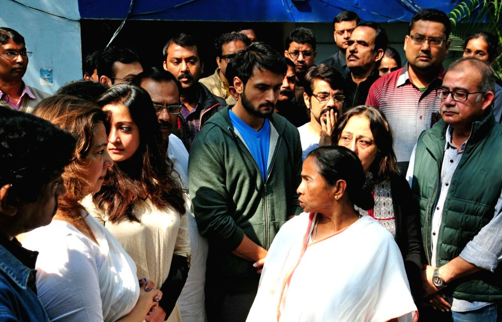 West Bengal Chief Minister Mamata Banerjee arrives to pay tribute to veteran Bengali film actress Supriya Devi who died at her South Kolkata residence following a massive heart attack in ... - Mamata Banerjee, Moon Moon Sen and Raima Sen