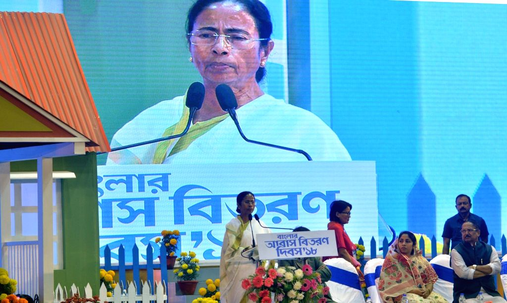 """West Bengal Chief Minister Mamata Banerjee addresses during a programme organised to handover documents to the beneficiaries of """"Bengal Awas Yojana"""" scheme in Kolkata, on Jan 29, ... - Mamata Banerjee"""