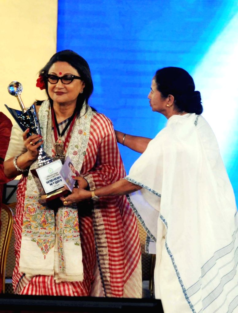 West Bengal Chief Minister Mamata Banerjee confers Mahanayak Samman on filmmaker Aparna Sen during an award ceremony, in Kolkata on July 24, 2018. - Mamata Banerjee