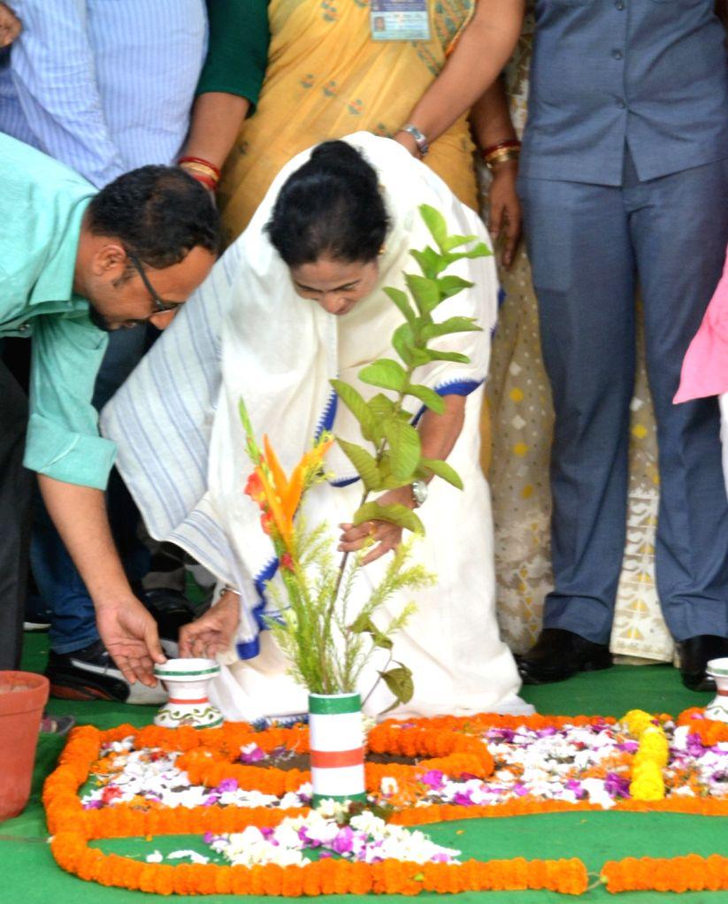 """West Bengal Chief Minister Mamata Banerjee celebrates """"Van Mahotsav"""" at State Assembly in Kolkata on July 27, 2018. - Mamata Banerjee"""