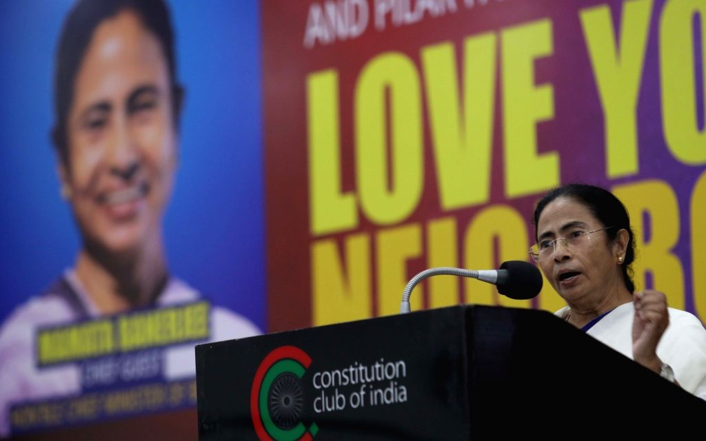 """West Bengal Chief Minister Mamata Banerjee addresses during a conference on """"Love for Neighbour"""", in New Delhi on July 31, 2018. - Mamata Banerjee"""