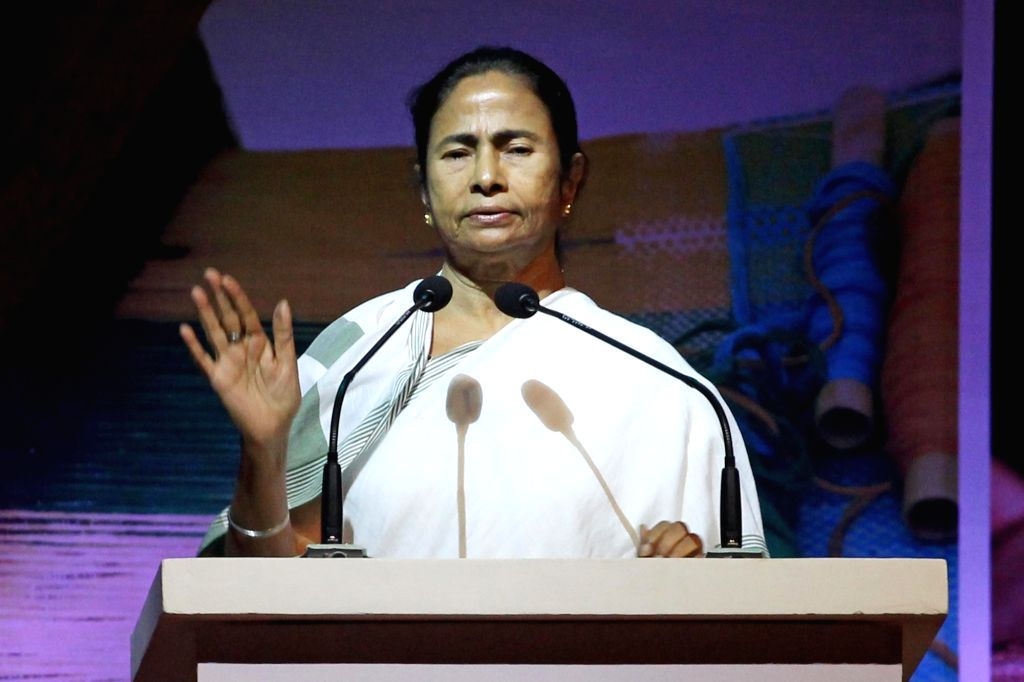 West Bengal Chief Minister Mamata Banerjee addresses at the inaugural programme of State MSME Conclave, in Kolkata on Aug 20, 2018. - Mamata Banerjee