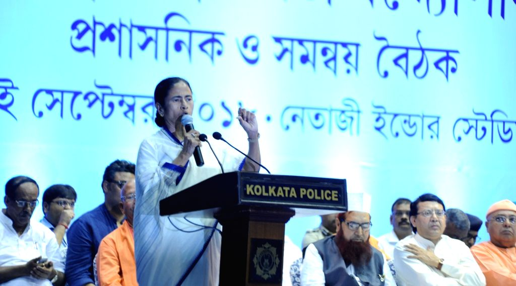 West Bengal Chief Minister Mamata Banerjee addresses during a meeting ahead of Durga Puja in Kolkata, on Sept 10, 2018. She announced a grant of Rs 10,000 and waiver of licence fee for each ... - Mamata Banerjee