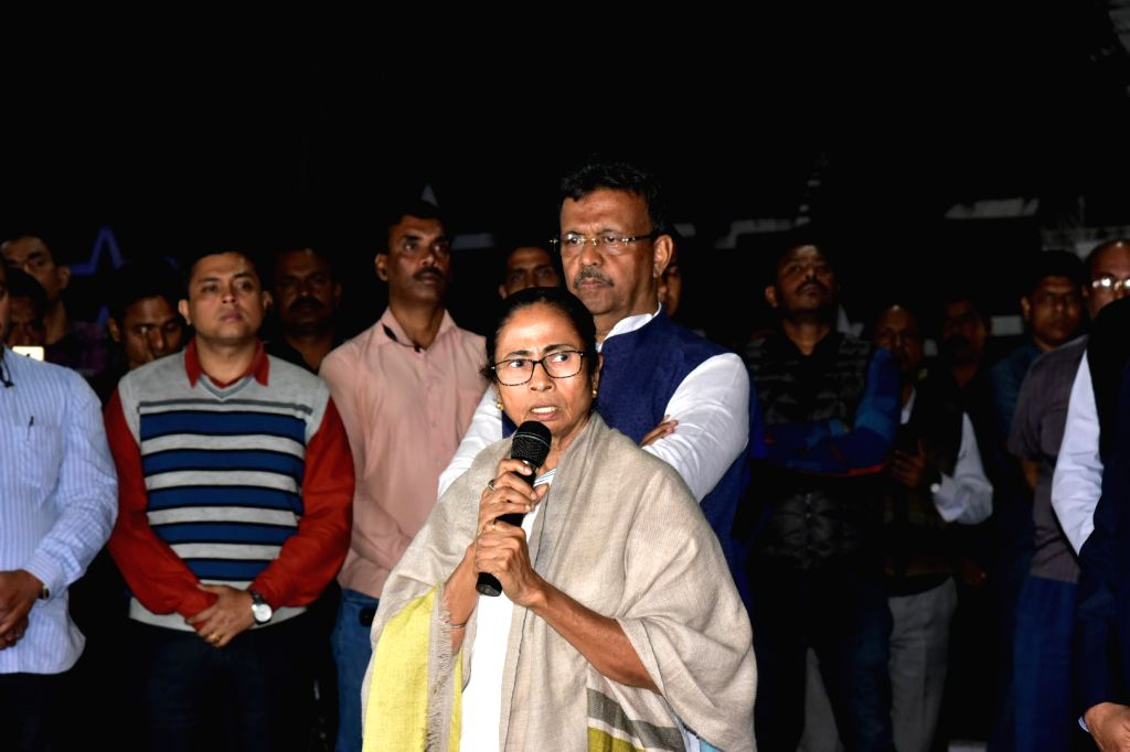 West Bengal Chief Minister Mamata Banerjee addresses media persons outside Kolkata Police Commissioner Rajeev Kumar's official residence in Kolkata on Feb 3, 2019. - Mamata Banerjee
