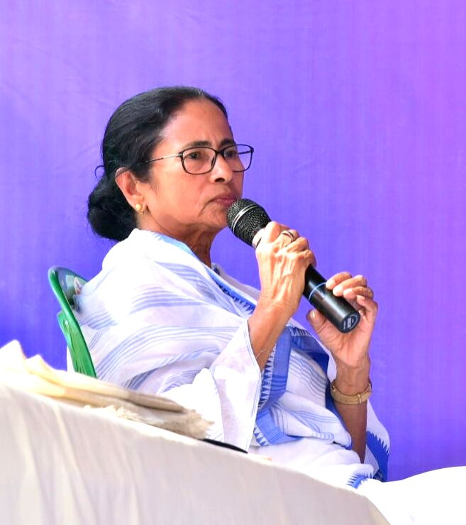 West Bengal Chief Minister Mamata Banerjee addresses during a sit-in (dharna) protest over the CBI's attempt to question Kolkata Police Commissioner Rajeev Kumar in connection with a ponzi ... - Mamata Banerjee