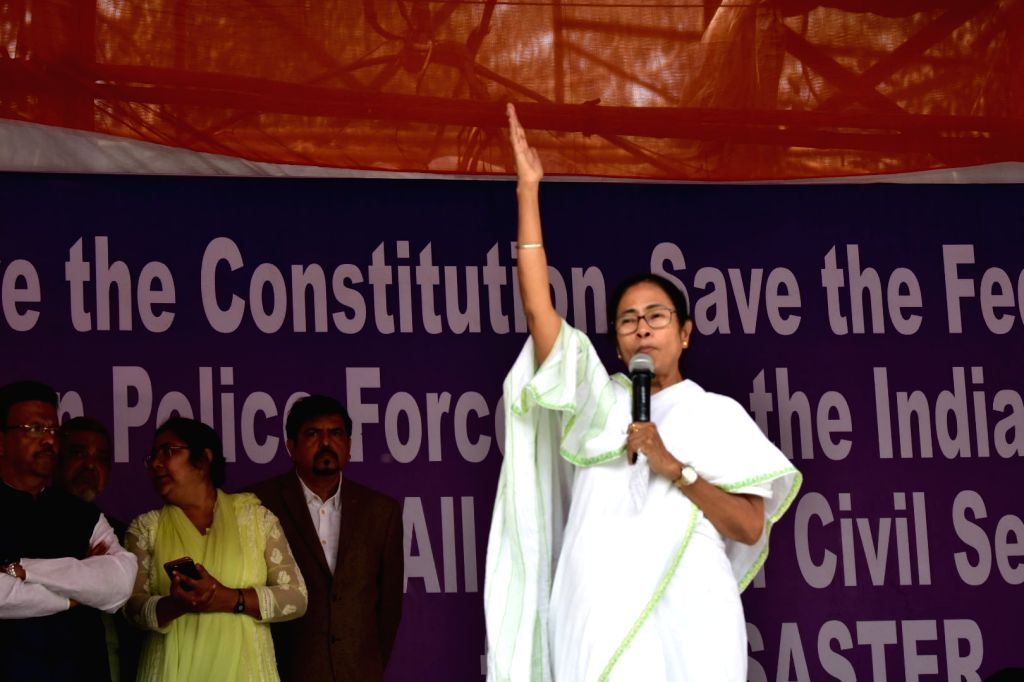West Bengal Chief Minister Mamata Banerjee addresses during a sit-in (dharna) demonstration over the CBI's attempt to question Kolkata Police Commissioner Rajeev Kumar in connection with a ... - Mamata Banerjee