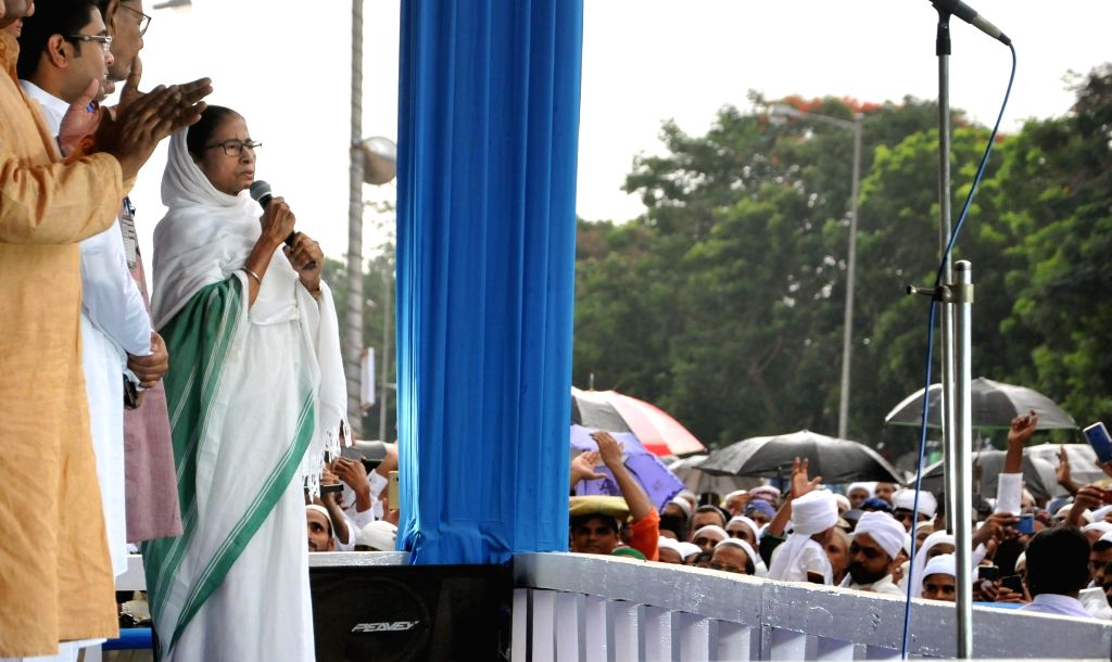 West Bengal Chief Minister Mamata Banerjee addresses at a programme on  Eid-ul-Fitr celebrations, in Kolkata, on June 5, 2019. - Mamata Banerjee