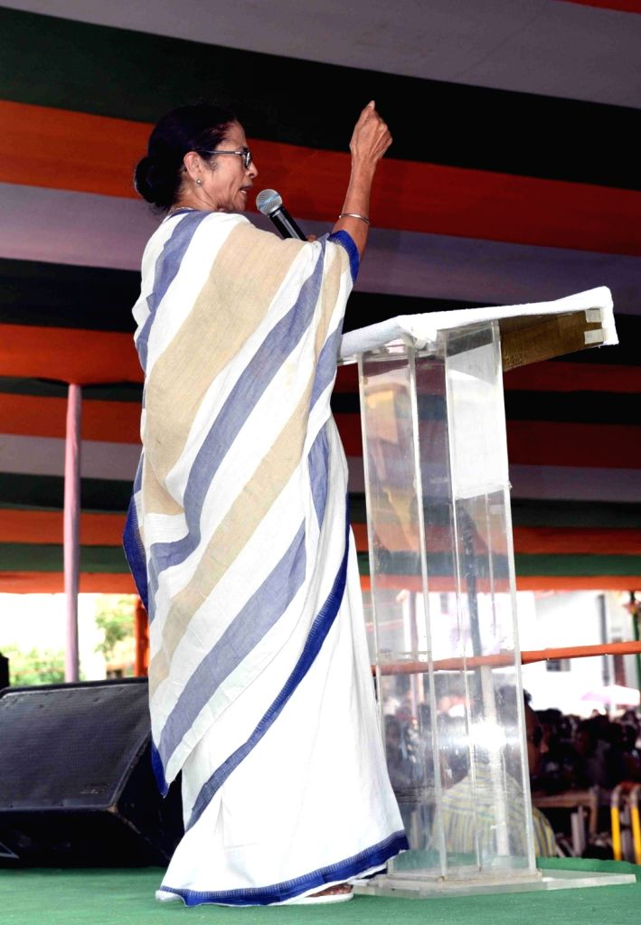 West Bengal Chief Minister Mamata Banerjee addresses during a Trinamool Congress workers' meeting at Kanchrapara, West Bengal on June 14, 2019. - Mamata Banerjee
