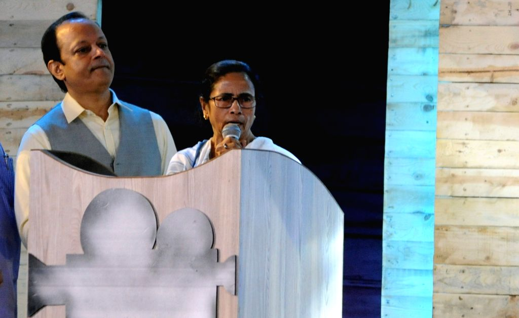 West Bengal Chief Minister Mamata Banerjee addresses during a programme organised on the death anniversary of actor Uttam Kumar, in Kolkata on July 24, 2019. - Mamata Banerjee and Uttam Kumar