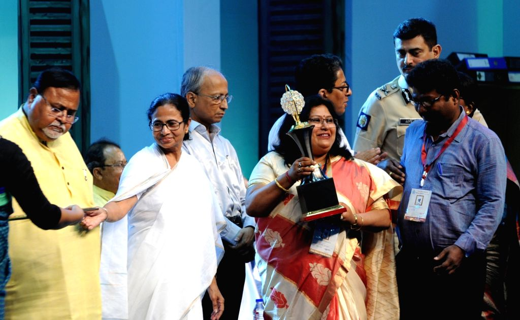 West Bengal Chief Minister Mamata Banerjee felicitates teachers with Shiksha Ratna Awards 2019 at an award ceremony on the occasion of Teachers' Day, in Kolkata on Sep 5, 2019. - Mamata Banerjee