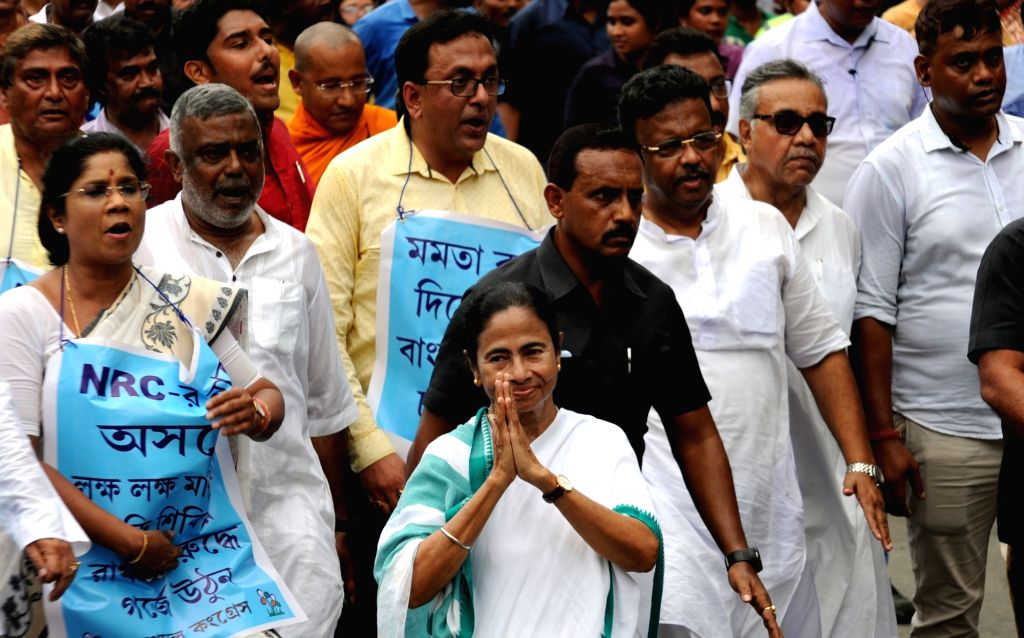 West Bengal Chief Minister Mamata Banerjee participate during in a rally to protest against National Register of Citizens (NRC) in Assam, from Sithi to Shyam bazar in Kolkata on Sep 12, 2019. - Mamata Banerjee