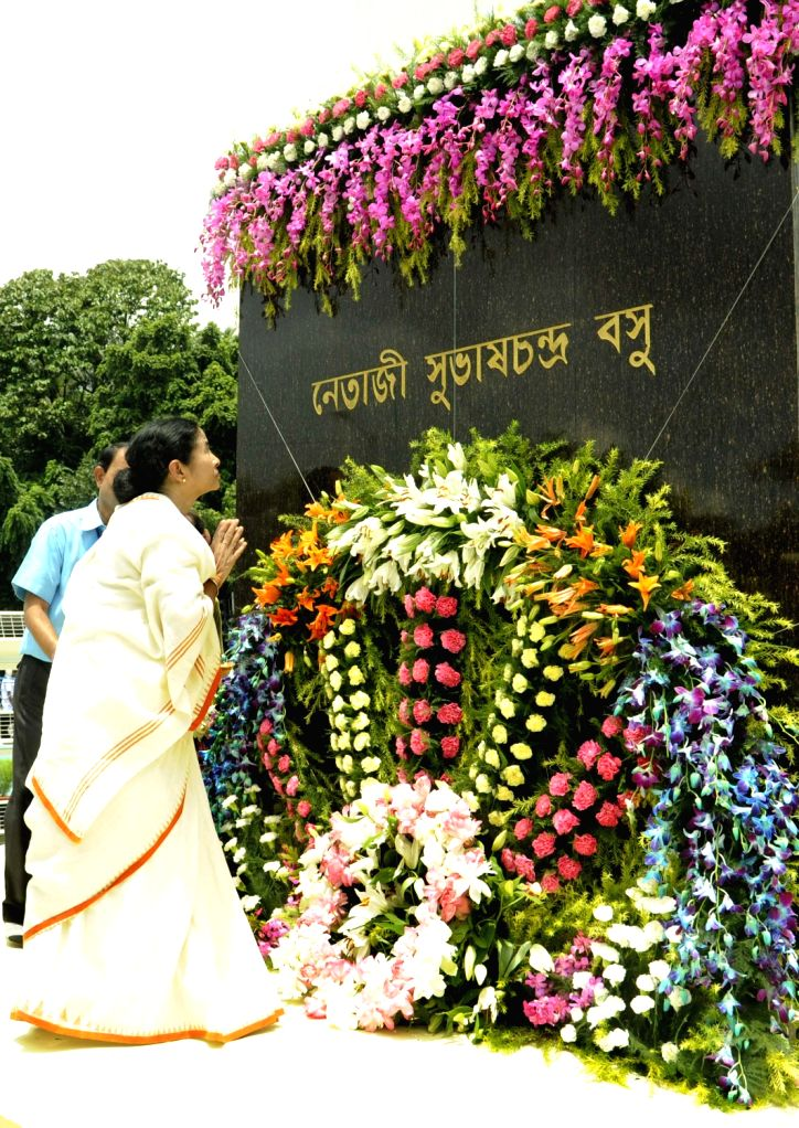 West Bengal  Chief Minister Mamata Banerjee  garlanding to the statue  of Netaji Subhash Chandra Bose during 67th Independence day celebration in Kolkata on 15,Aug,2013. (Photo::: IANS) - Mamata Banerjee