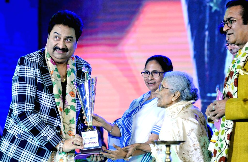 West Bengal Chief Minister Mamata Banerjee, singers Sandhya Mukherjee, Kumar Sanu and Abhijeet Bhattacharya during the inauguration of 'Bangla Sangeet Mela 2019' in Kolkata on Dec 4, 2019. - Mamata Banerjee and Sandhya Mukherjee