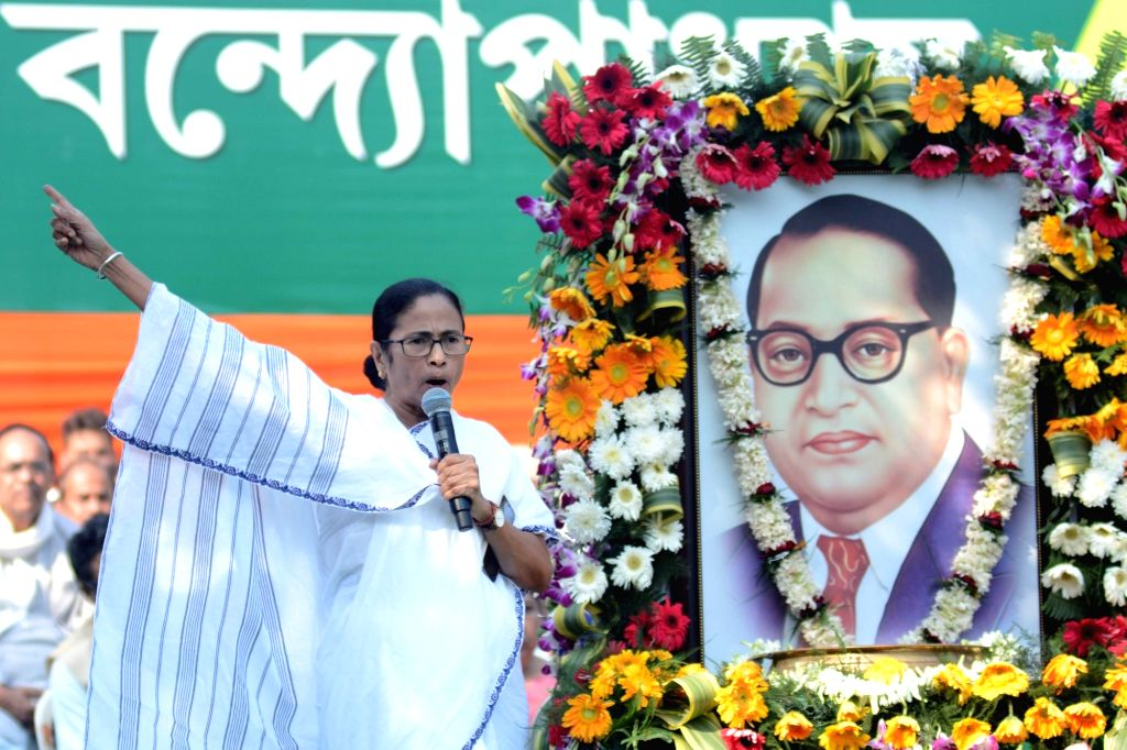 West Bengal Chief Minister Mamata Banerjee addresses during a progranmne organised to pay tributes to Dr B.R. Ambedkar on his 64th death anniversary commemorated as Mahaparinirvan Diwas, in ... - Mamata Banerjee