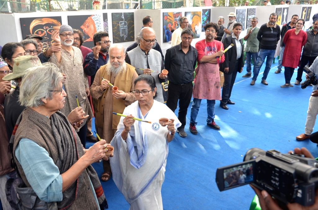West Bengal Chief Minister Mamata Banerjee accompanied by with artists, participates in a painting programme organised as part of a protest against the Citizenship Amendment Act (CAA) 2019, ... - Mamata Banerjee