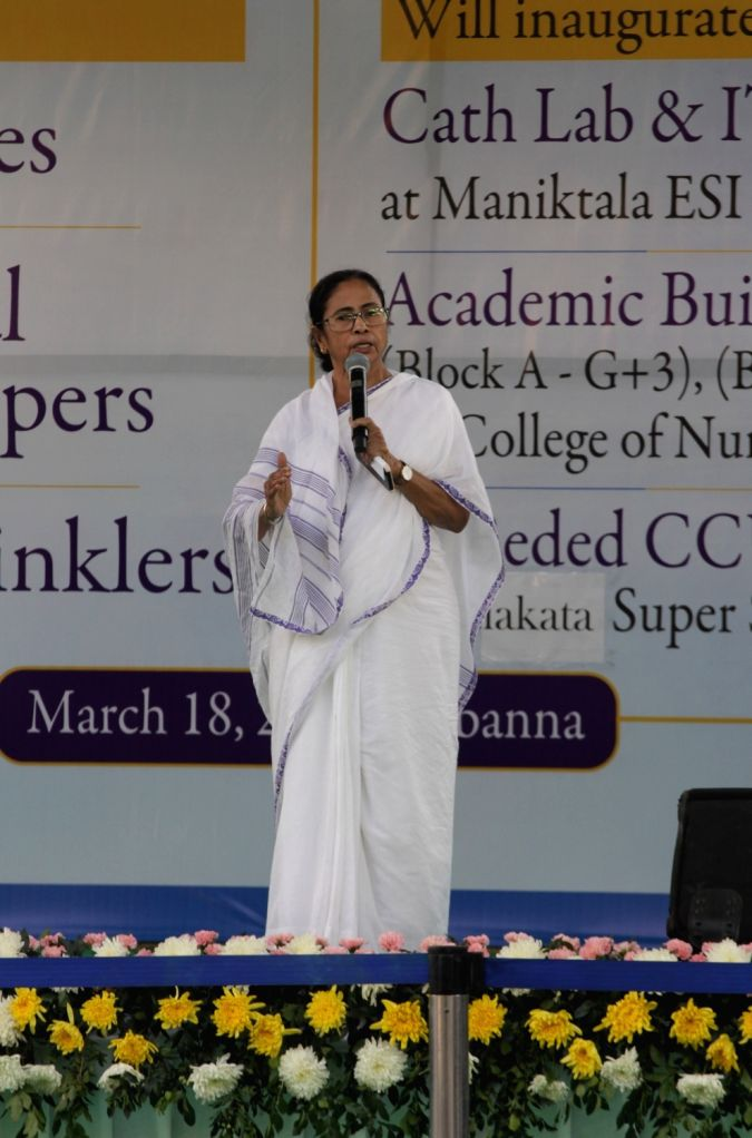 West Bengal Chief Minister Mamata Banerjee addresses during a welfare programme organised in the wake of COVID-19 (coronavirus) pandemic at Nabanna in Howrah on March 18, 2020. - Mamata Banerjee