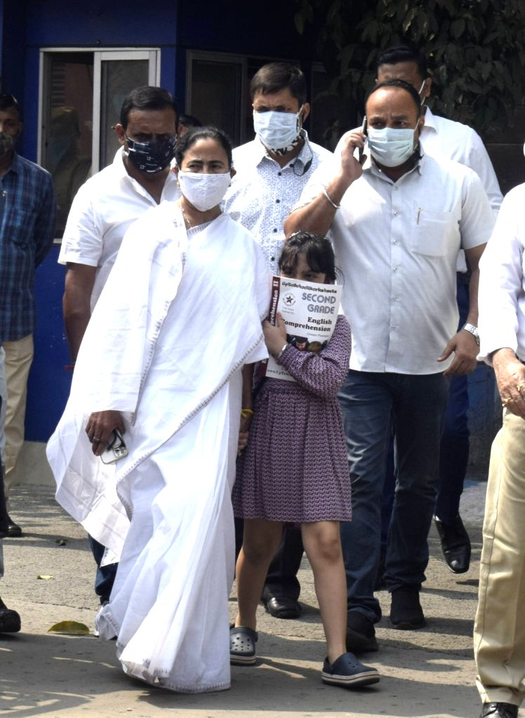 West Bengal Chief Minister Mamata Banerjee along with TMC MP Abhishek Banerjee's daughter, comes out of Abhishek Banerjee's house in Kolkata on Feb 23, 2021. - Mamata Banerjee and Abhishek Banerjee