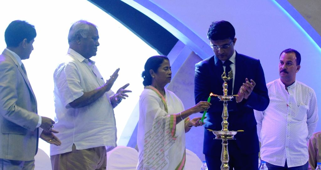 West Bengal Chief minister Mamata Banerjee along with Cricket Association of Bengal (CAB) President Sourav Ganguly lights the lamp during CAB Annual Awards Ceremony 2016-17 in Kolkata on Aug ... - Mamata Banerjee and Sourav Ganguly