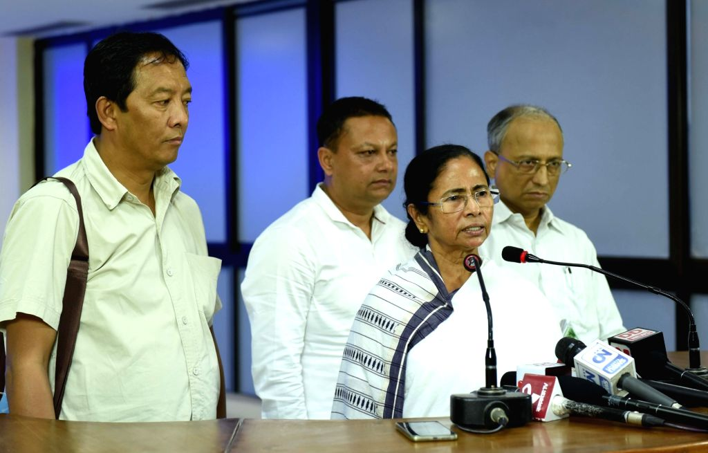 West Bengal Chief Minister Mamata Banerjee along with ousted Gorkha Janamukti Morcha leader Binay Tamang addresses a press conference regarding Darjeeling unrest, at Nabanna in Howrah on Sept ... - Mamata Banerjee