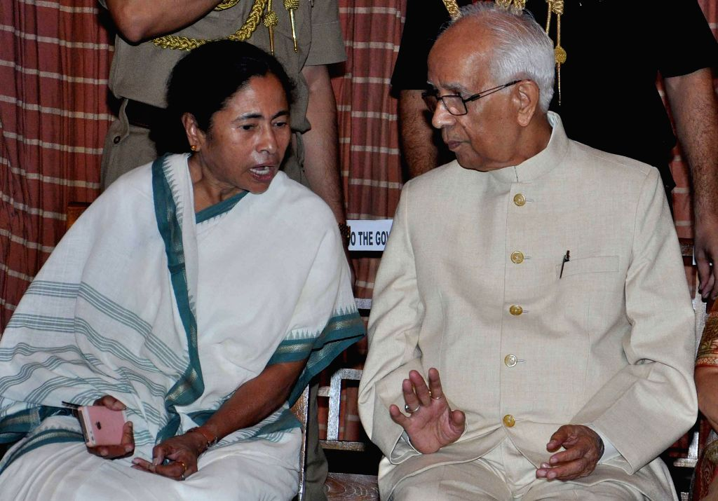 West Bengal Chief Minister Mamata Banerjee and New Governor of West Bengal Keshari Nath Tripathi during Governor's oath taking ceremony at Raj Bhawan in Kolkata on July 24, 2014. - Mamata Banerjee